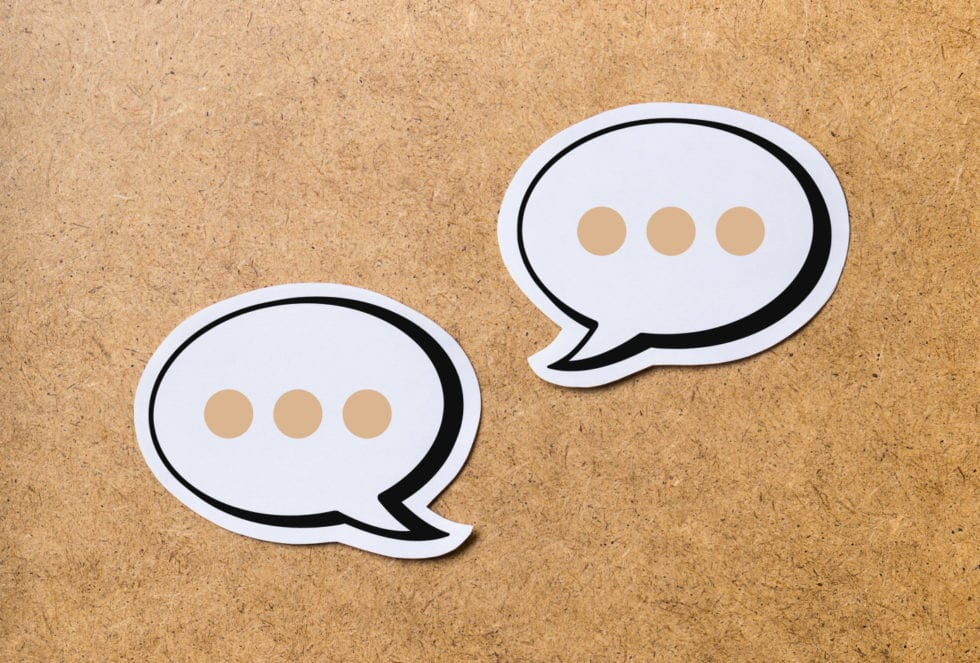 a picture of two speech bubbles with typing dots