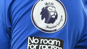 soccer jersey with premier league logo and no room for racism tagline